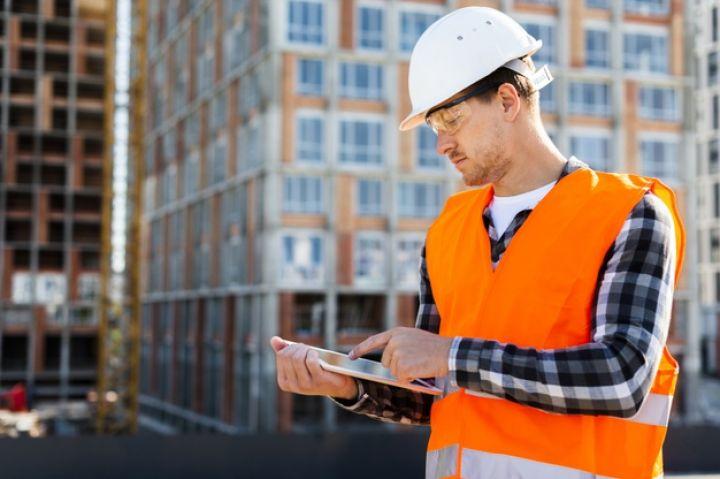 medium-shot-side-view-construction-engineer-using-tablet_23-2148233673.jpg